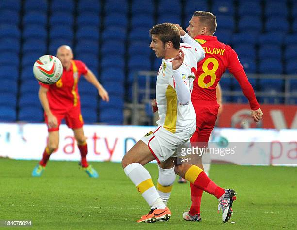 Wales's Craig Bellamy challenges Macedonia's Stefan Ristovski during the World Cup 2014 Group A qualifying football match between Wales and Macedonia...