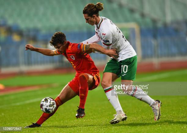 Wales's defender Neco Williams fights for the ball with Bulgaria's forward Bozhidar Kraev during the UEFA Nations League Group B4 football match...