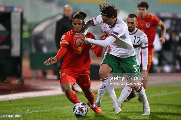 Wales's defender Tyler Roberts fights for the ball Bulgaria's midfielder Kristian Dimitrov during the UEFA Nations League Group B4 football match...