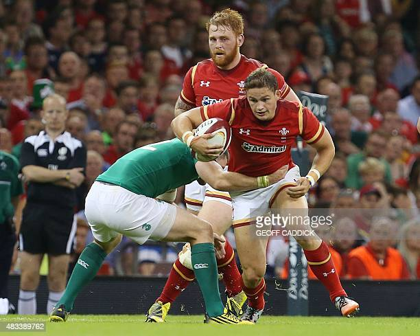 Wales's full back Hallam Amos is tackled by Ireland's hooker Richardt Strauss during the 2015 Rugby World Cup warm up rugby union match between Wales...