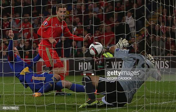 Wales's midfielder Aaron Ramsey scores a goal past Andorra's goalkeeper Ferran Pol Perez during the Euro 2016 qualifying football match between Wales...