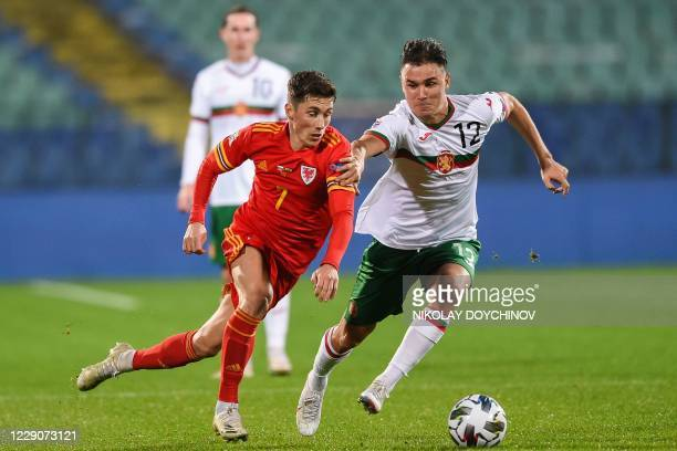 Wales's midfielder Harry Wilson fights for the ball with Bulgaria's midfielder Yanis Karabelyov during the UEFA Nations League Group B4 football...