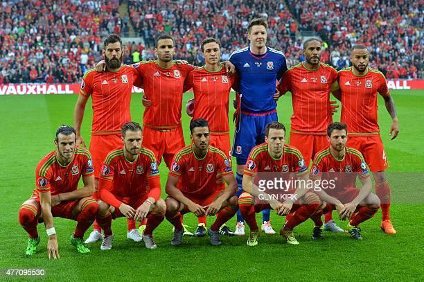 Wales's midfielder Joe Ledley Wales's midfielder Hal RobsonKanu Wales's defender James Chester Wales's goalkeeper Wayne Hennessey Wales's defender...