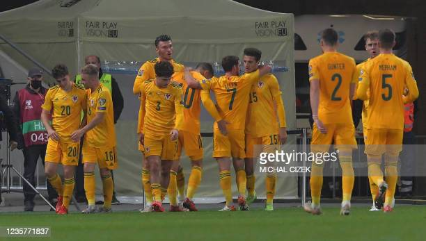 Wales's players celebrate after scoring the opening goal during the FIFA World Cup Qatar 2022 qualification Group E football match between the Czech...