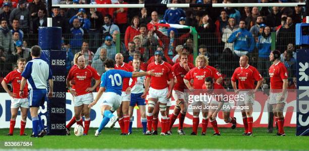 Wales's team line up as Italy's Ramiro Pez seals a 2320 victory with a conversion during the RBS 6 Nations match at the Stadio Flaminio Rome Italy