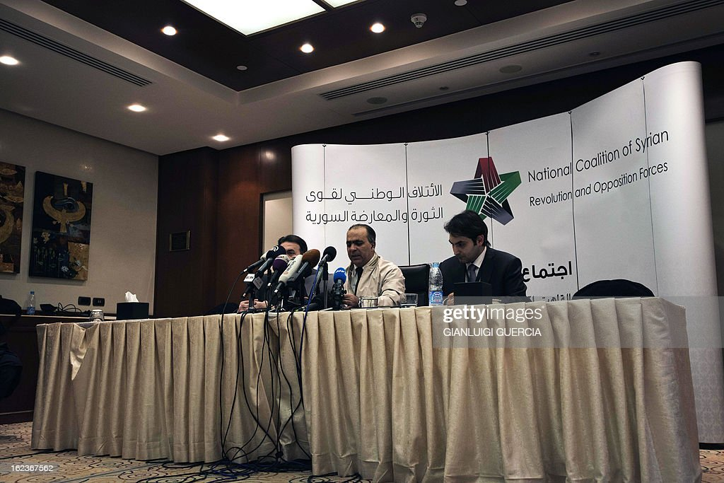 Walid Al Bunni (C), spokesman for the National Coalition of Syrian revolution and opposition forces, gives a press conference on February 22, 2013 in Cairo. The opposition National Coalition said Friday it will form a government to run 'liberated areas' of Syria, as monitors said more than 12 people were killed when buildings collapsed in a missile strike on the city of Aleppo. GUERCIA