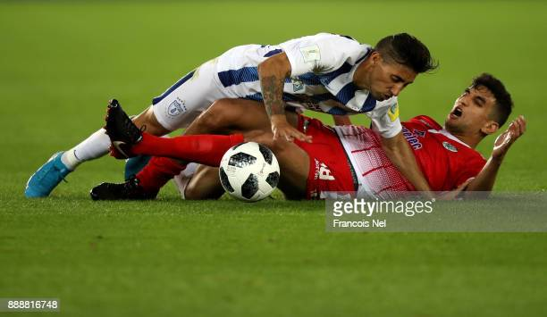 Walid El Karti of Wydad Casablanca fouls Jonathan Urretavizcaya of Pachuca during the FIFA Club World Cup match between CF Pachuca and Wydad...