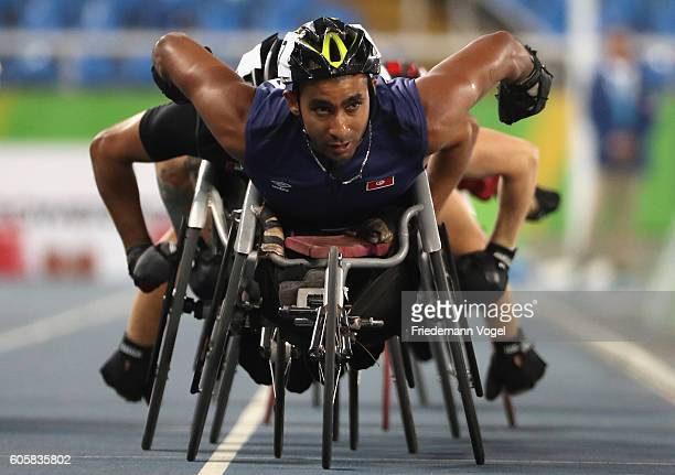 Walid Ktila of Tunisia leads the pack in the Men's 800m T34 Final on day 7 of the Rio 2016 Paralympic Games at the Olympic Stadium on September 14...