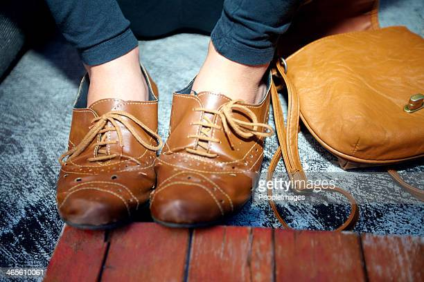 walk a mile in her trendy shoes - brown shoe stock photos and pictures
