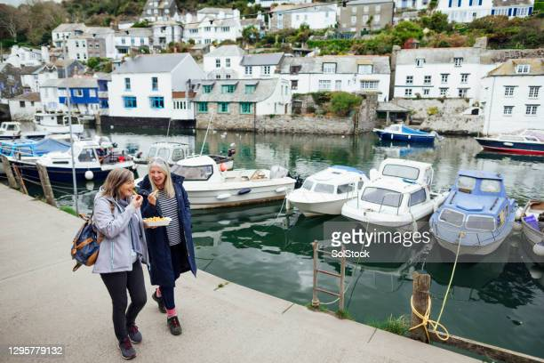 a walk along the harbour - south west england stock pictures, royalty-free photos & images