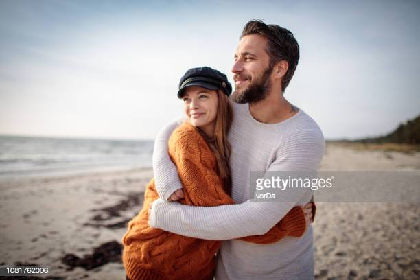 walk by the beach - young couple stock pictures, royalty-free photos & images