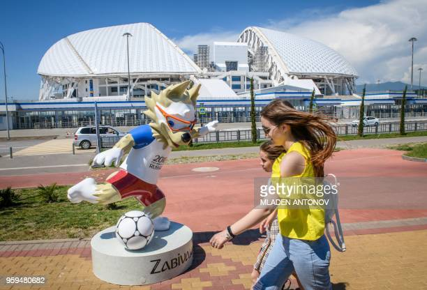 TOPSHOT A walk front in front of the Fisht Olympic Stadium in Sochi on May 17 2018 During the 2018 FIFA World Cup in Russia the 40000seater stadium...