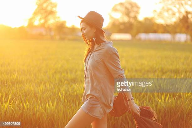 walk in sunlight - green shorts stock photos and pictures
