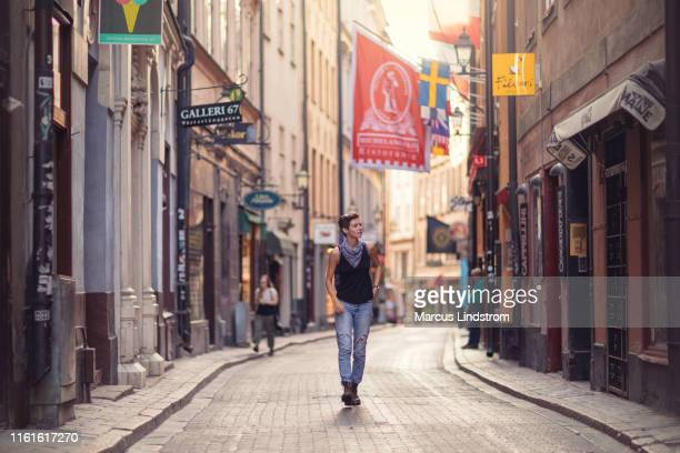 a walk in the streets of gamla stan, stockholm - stockholm stock pictures, royalty-free photos & images