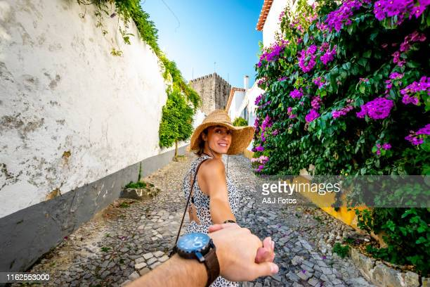 a walk in the streets of obidos, portugal - following stock pictures, royalty-free photos & images
