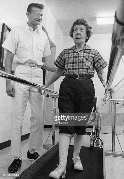 FEB 3 1966 MAR 2 1966 Walk it's good for you Jerry Kurtz a Spalding House attendant seems to be telling patient Cora Riggle as he helps her walk...