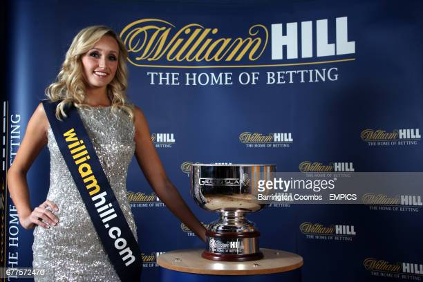 Walk on girl Sarah Tunnicliffe with the Williamhillcom 2011 Grand Slam Darts Final trophy