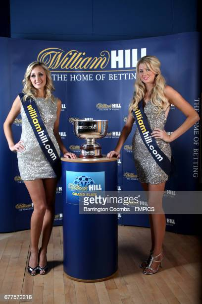Walk on girls Sarah Tunnicliffe and Nicola Cowell with the Williamhillcom 2011 Grand Slam Darts Final trophy
