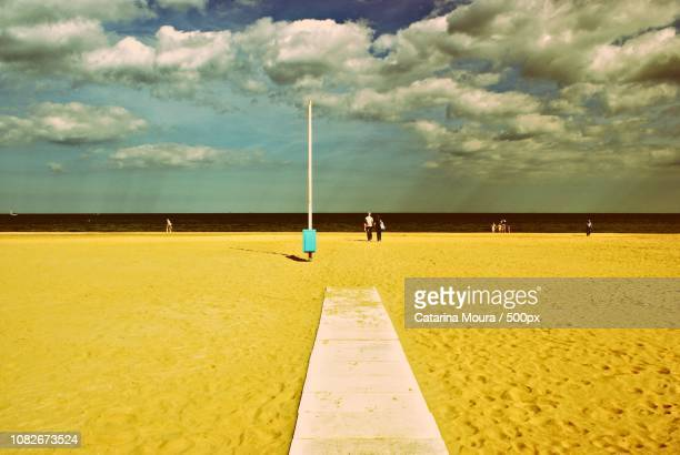 a walk on the beach - moura stock photos and pictures