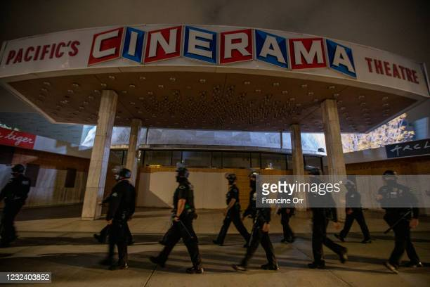 Walk past the now closed iconic Cinerama Dome as they follow a group through the streets of Hollywood. An anti-police brutality vigil took place near...