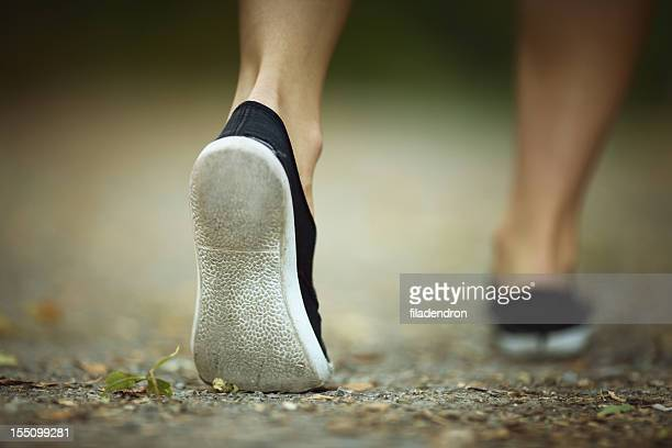 walk - woman soles stock photos and pictures