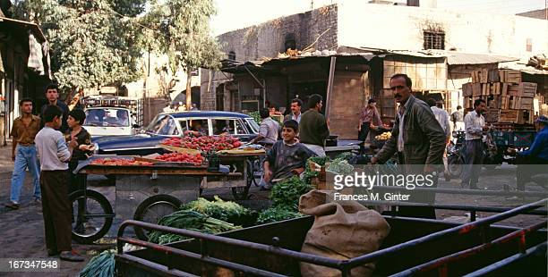 Walk through the old town of Caravanserai via souks to citadel Aleppo Syria October 1992