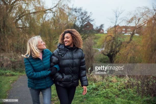 walk through the park with my mam - active lifestyle stock pictures, royalty-free photos & images