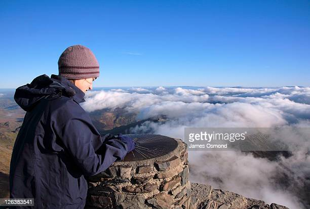 walker above the clouds on the summit of mount snowdon - gwynedd stock photos and pictures