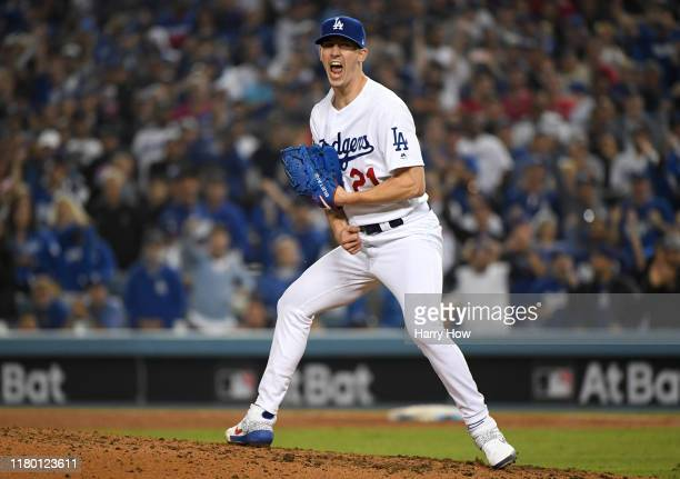 Walker Buehler of the Los Angeles Dodgers celebrates after striking out Ryan Zimmerman of the Washington Nationals for the third out of the sixth...