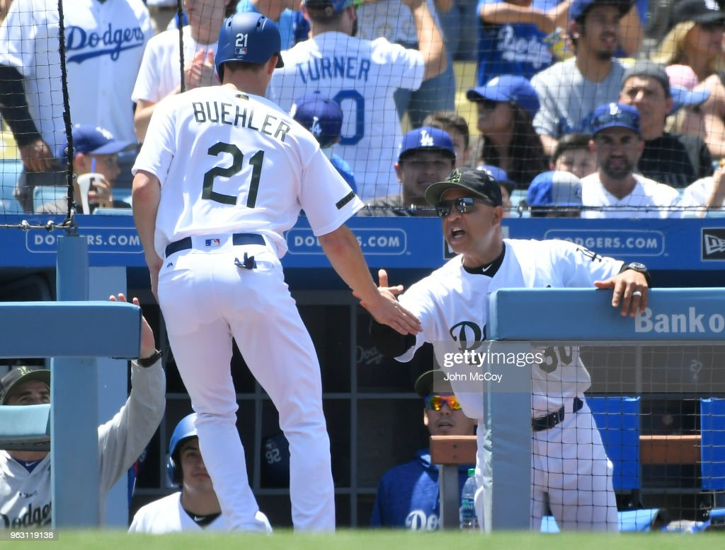Walker Buehler #21 of the Los Angeles Dodgers is congratulated on scoring in the third inning against the San Diego Padres at Dodger Stadium on May 27, 2018 in Los Angeles, California.