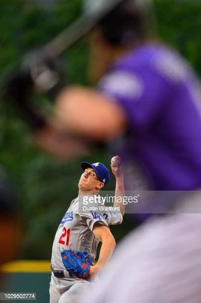 Walker Buehler of the Los Angeles Dodgers pitches against Charlie Blackmon of the Colorado Rockies in the first inning of a game at Coors Field on...