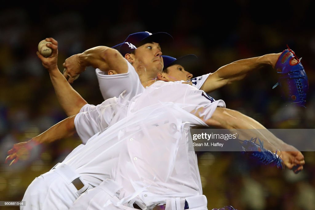 Walker Buehler #21 of the Los Angeles Dodgers pitches during the third inning of a game at Dodger Stadium on April 23, 2018 in Los Angeles, California.