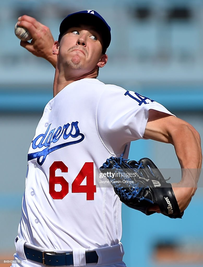 Walker Buehler #64 of the Los Angeles Dodgers pitches in the ninth inning against the Colorado Rockies at Dodger Stadium on September 10, 2017 in Los Angeles, California.