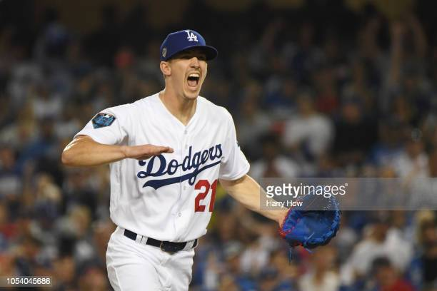 Walker Buehler of the Los Angeles Dodgers reacts after retiring the side during the fourth inning against the Boston Red Sox in Game Three of the...