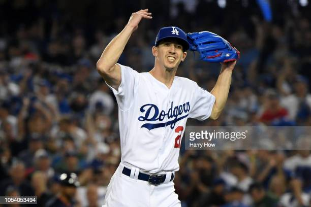 Walker Buehler of the Los Angeles Dodgers reacts after retiring the side on a strike out during the seventh inning against the Boston Red Sox in Game...
