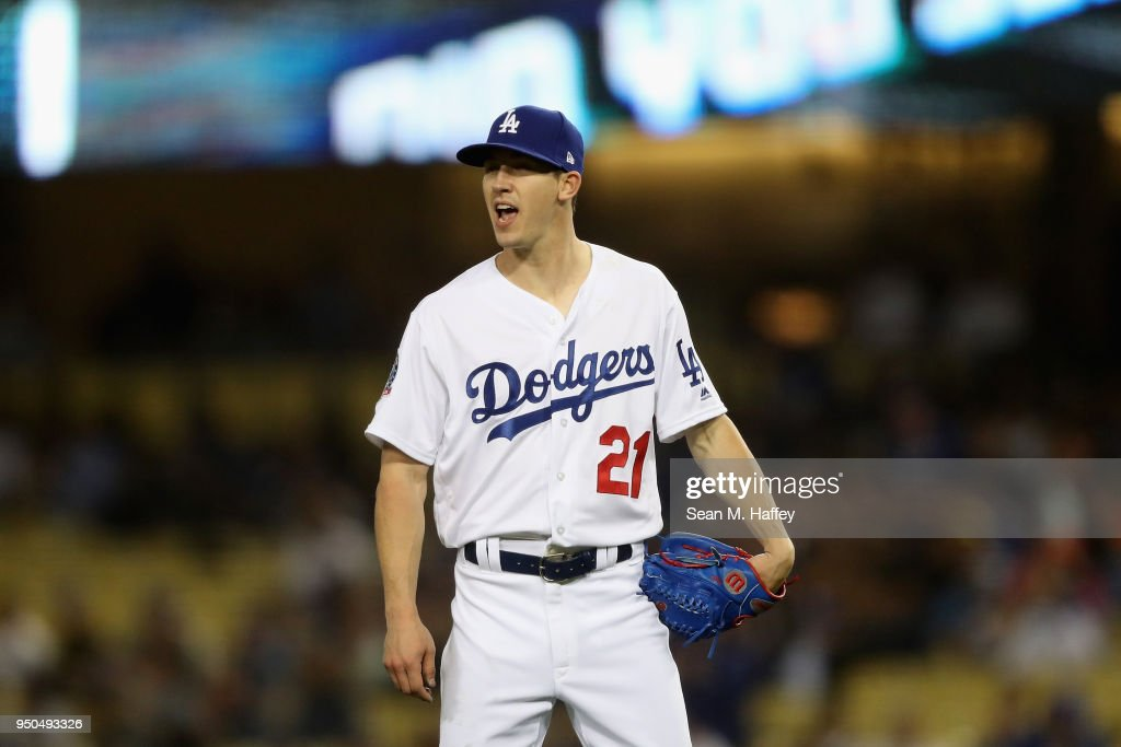 Walker Buehler #21 of the Los Angeles Dodgers reacts to an out during the third inning of a game against the Miami Marlins at Dodger Stadium on April 23, 2018 in Los Angeles, California.