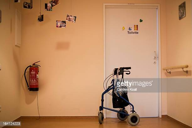 A walker is facing a door next to a fire extinguisher in the geriatric day care facility of the German Red Cross at Villa Albrecht on March 11 2013...