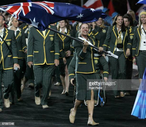 Walker Jane Saville flag bearer for Australia leads her team mates during the Opening Ceremony for the Melbourne 2006 Commonwealth Games at the...