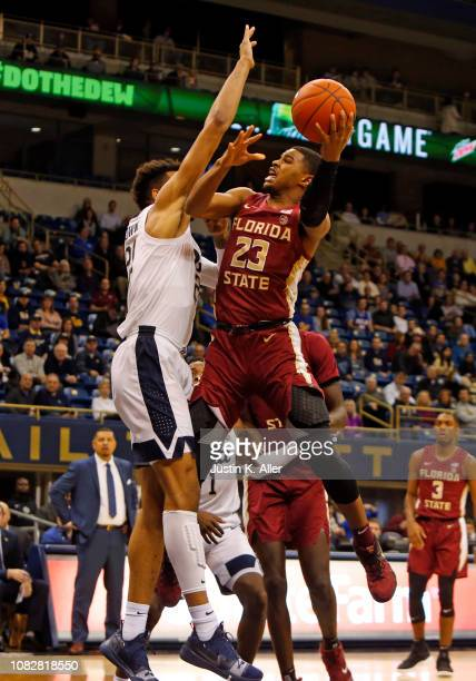 J Walker of the Florida State Seminoles drives the lane against Terrell Brown of the Pittsburgh Panthers at Petersen Events Center on January 14 2019...
