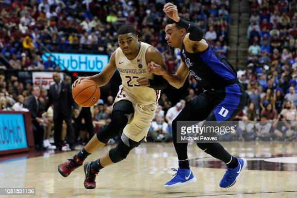 J Walker of the Florida State Seminoles drives to the basket against Tre Jones of the Duke Blue Devils during the first half at Donald L Tucker...
