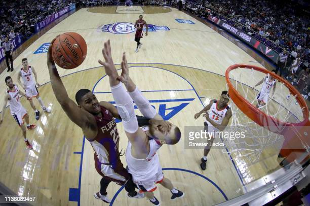 J Walker of the Florida State Seminoles drives to the basket against Jack Salt of the Virginia Cavaliers during their game in the semifinals of the...