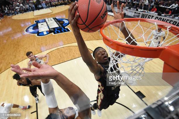Walker of the Florida State Seminoles drives to the basket against Rui Hachimura of the Gonzaga Bulldogs during the 2019 NCAA Men's Basketball...