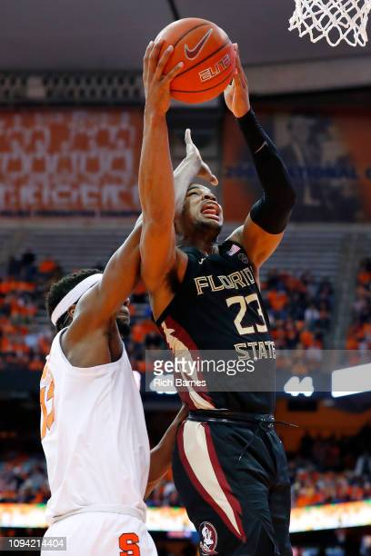 J Walker of the Florida State Seminoles is fouled by Paschal Chukwu of the Syracuse Orange on a shot during the second half at the Carrier Dome on...