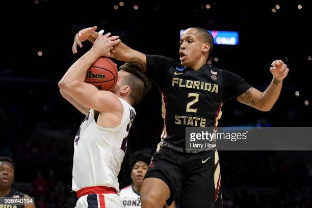 Walker of the Florida State Seminoles tries to block the shot of Corey Kispert of the Gonzaga Bulldogs in the second half in the 2018 NCAA Men's...