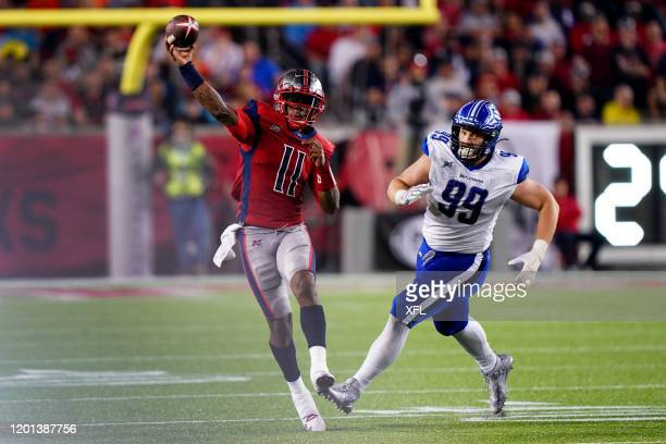 J Walker of the Houston Roughnecks running and passing to get away from Jake Payne of the St Louis BattleHawks at TDECU Stadium on February 16 2020...