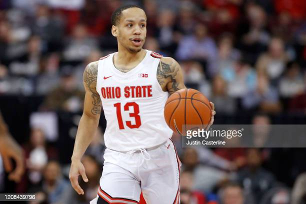 Walker of the Ohio State Buckeyes brings the ball up the court in the game against the Maryland Terrapins at Value City Arena on February 23 2020 in...