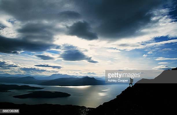 a walker on ben mor coigach in the north west highl;ands of scotland - ben cooper stock-fotos und bilder