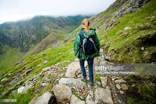 a walker on snowdon - mount snowdon stock photos and pictures