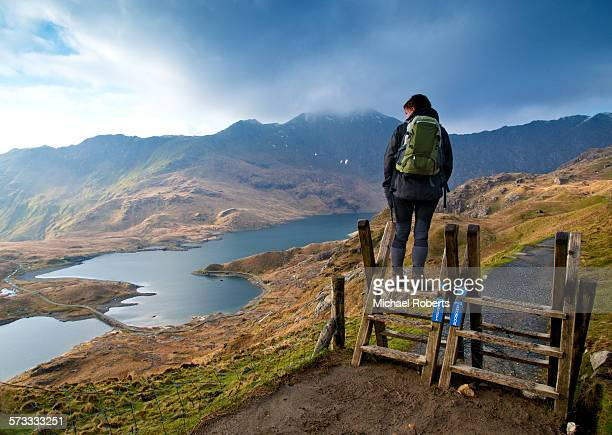 walker on the pyg track ascending snowdon - mount snowdon stock photos and pictures