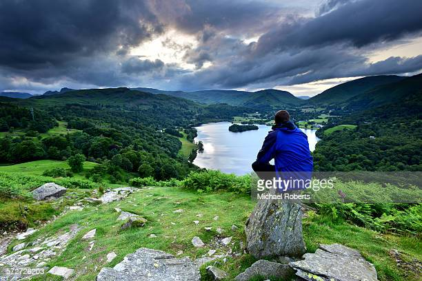 walker overlooking grasmere in the lake district - english lake district stock photos and pictures